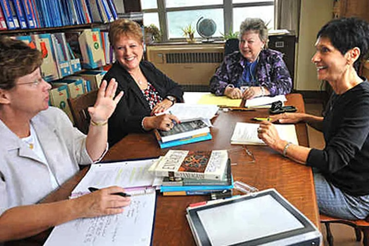 Sister Pat Mengel (left), Linda Robinson, Carolynne Ervin, Pat Latshaw meet at the library at Chestnut Hill College for a postgraduate program. Ervin is coordinator of the spiritual direction practicum, and the others are students. (Bonnie Weller / Staff)