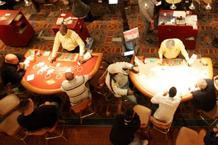 Gamblers sit at tables at the Tropicana Casino in Atlantic City. (David Swanson / Staff Photographer)