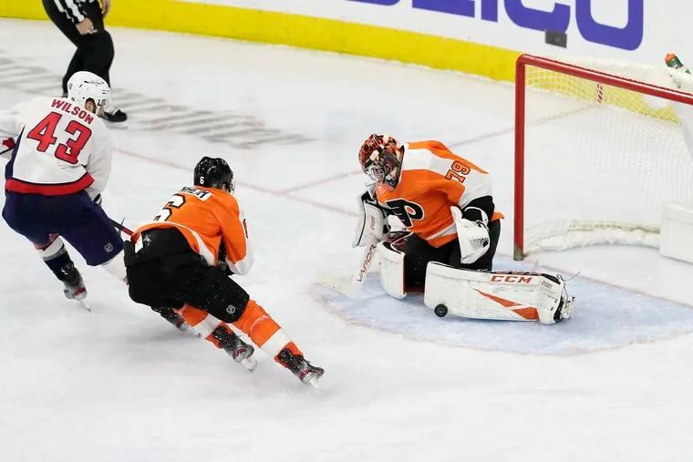 Flyers goaltender Carter Hart blocking a shot by Washington's Tom Wilson (43) in a Jan. 8 game at the Wells Fargo Center. The Flyers won, 3-2.