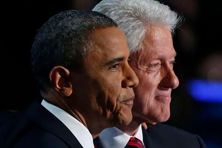 President Barack Obama stands with former President Bill Clinton after Clinton's address to the Democratic National Convention in Charlotte, N.C. President Obama in Charlotte last week. Unlike Mitt Romney, Obama made foreign policy a major focus of his speech. (AP Photo/Carolyn Kaster, File)