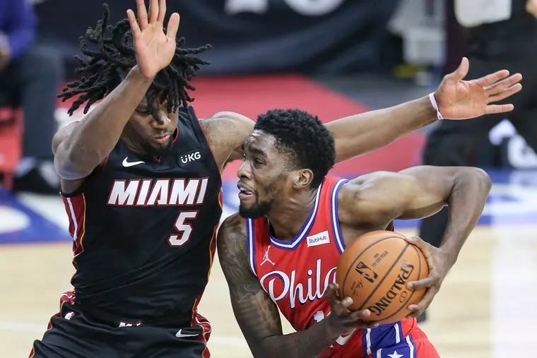 Sixers' Shake Milton drives on Heat's Precious Achiuwa  during the 2nd quarter at the Wells Fargo Center in Philadelphia, Thursday,  January 14, 2021.