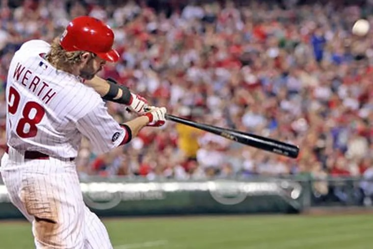 Jayson Werth connects for a two run homer against the Red Sox during the fifth inning last night. (Steven M. Falk / Staff Photographer)