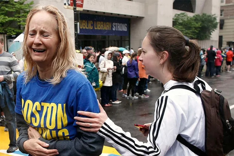 Pam Vingsness (right) comforts her mother, Rachel, of Newton, Mass., after they ran the last mile of the Boston Marathon route in a symbolic gesture for those who didn't finish last month.