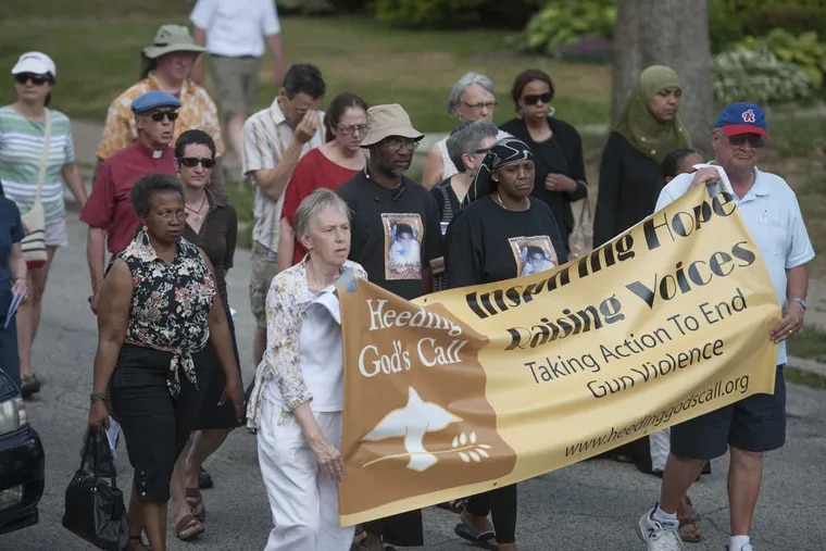 Members of Heeding God's Call, which seeks to end gun violence, marching toward a rally in May 2015 at the site where James Stuhlman was slain.