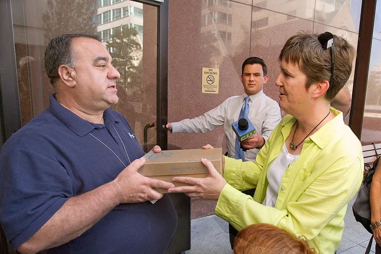 Former Waldron Mercy Academy teacher Margie Winters was not allowed in the building, but an archdiocesan representative accepted the box of signed petitions. CHARLES FOX / Staff Photographer