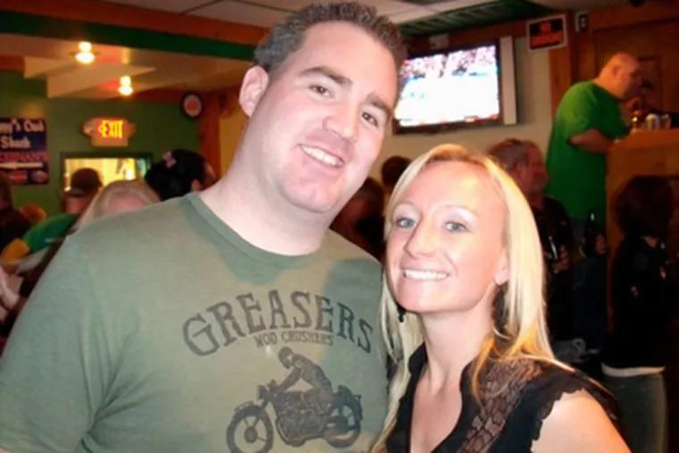 Scott Jackson with Kim Pawlowski, whose husband, John, Jackson's friend, was killed in the line of duty.