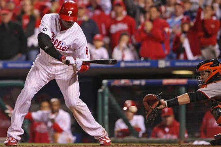 Ryan Howard watches the final pitch of the Phillies' season go by him and into the mitt of Giants catcher Buster Posey. The third strike against Howard stranded two runners and gave San Francisco a 3-2, Game 6 win and the National League pennant.