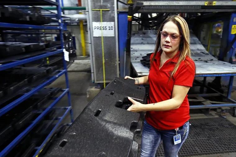 Mold tech Haley George takes parts to a rack to cool after they have been molded at the JSP International plant in Tullahoma, Tenn. JSP's U.S. corporate headquarters are in Wayne. Just over a year ago, George was in jail, recovering from a drug addiction. Now, she says, her life has completely changed for the better.