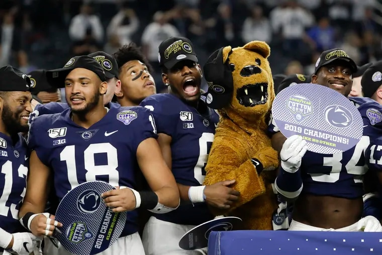 Penn State players and the Nittany Lion mascot celebrate their Cotton Bowl win over Memphis.