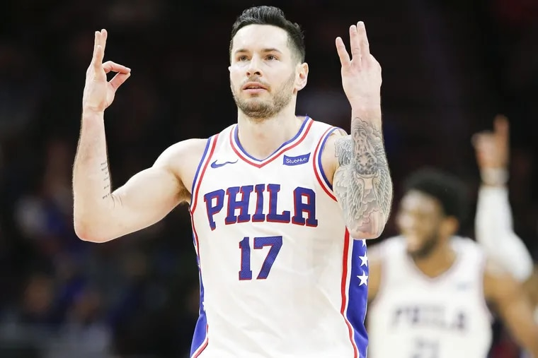 Sixers guard JJ Redick raises his hand after making a three-point basket against the Los Angeles Clippers on Saturday, February 10, 2018 in Philadelphia.