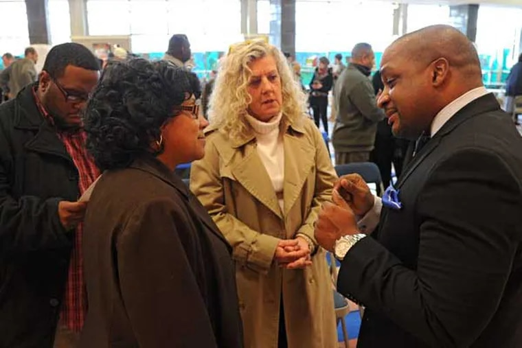 """Ronald G. Taylor (right), a candidate for Camden school superintendent, talks with Jacquelyn Jefferson (cq, 2n from left), Camden District Test Coordinator, and Linda Delengowski (center) Art Dept. Chair and teacher at Camden High, during a """"meet and greet"""" at Octavius Catto School March 26, 2013.  ( CLEM MURRAY / Staff Photographer )"""