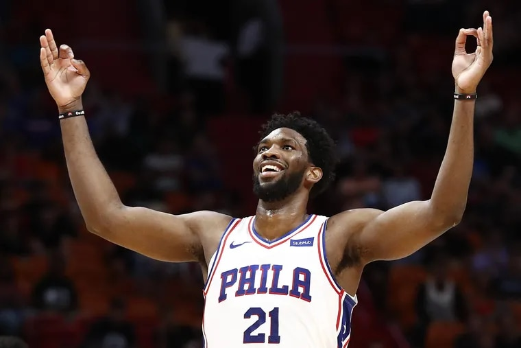Joel Embiid celebrating after scoring a three-point basket against the Heat on Monday.