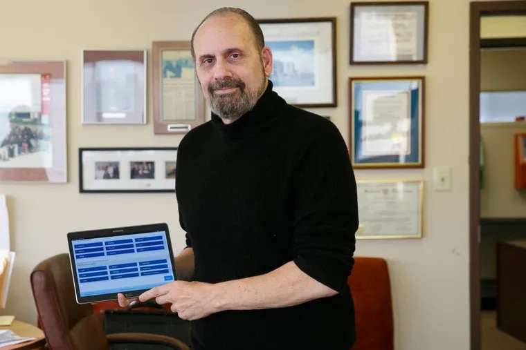 Mike Manning, CEO and founder of CarePartners Plus, shown here in his Horsham office, reinvented himself from an Army officer and hospital CEO to engineer software that helps veterans like himself access healthcare and benefits, Friday, Dec. 1, 2017. Called GetVetsHelp, the app was in pilot testing at the VA here in Philly. JESSICA GRIFFIN / Staff Photographer . .