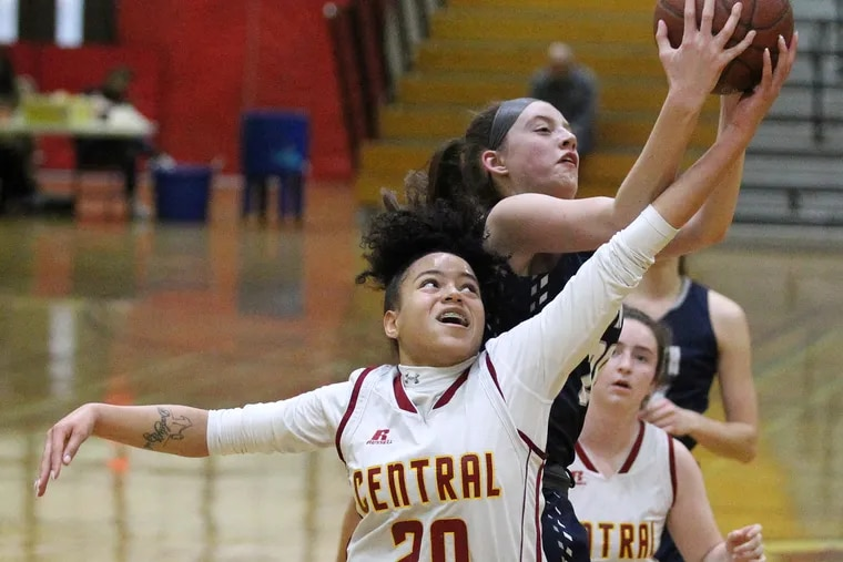 Bene Butler of Central and Sydney Blum, top, of Council Rock North battle for a rebound in a game on March 8, 2019. Butler scored 13 points in Central's win over Audenried on Friday.