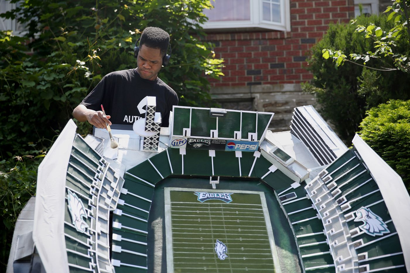 Artist with autism creates Lincoln Financial Field sculpture for Eagles Autism Challenge