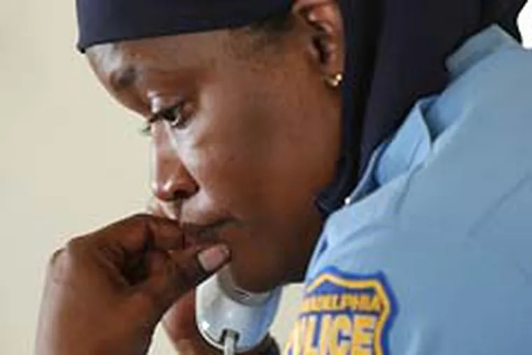 A court ruled Wednesday that Philadelphia police officer Kimberlie Webb can not wear her Muslim head scarf while on duty. (John Costello / Staff File Photo)