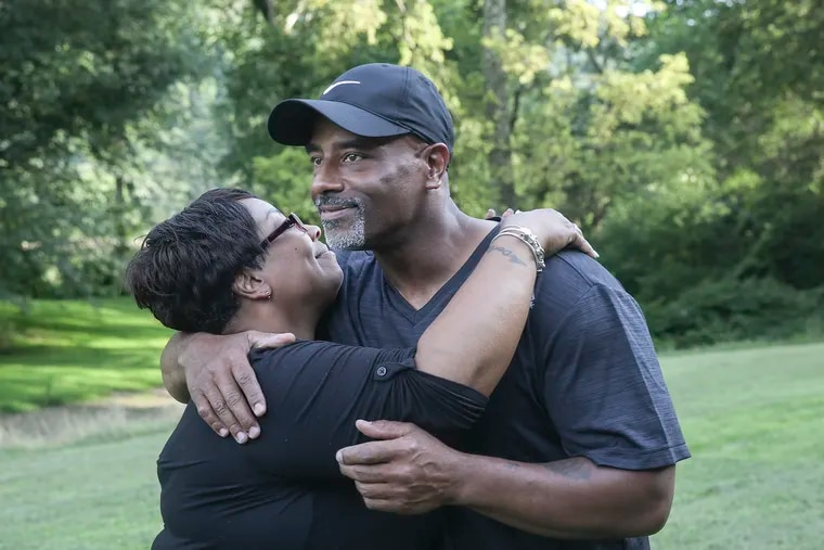 Chester Hollman III hugs his sister Deanna after he was released from the State Correctional Institution at Retreat in Hunlock Creek in 2019 after serving 28 years of a life sentence for a murder for which he was innocent.