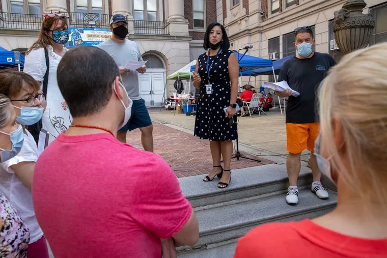 Evelyn Nuñez (center), Philadelphia School District chief of schools, ordered Masterman teachers working outside to go into the building. The teachers said they would not do so until they got answers about their asbestos concerns.
