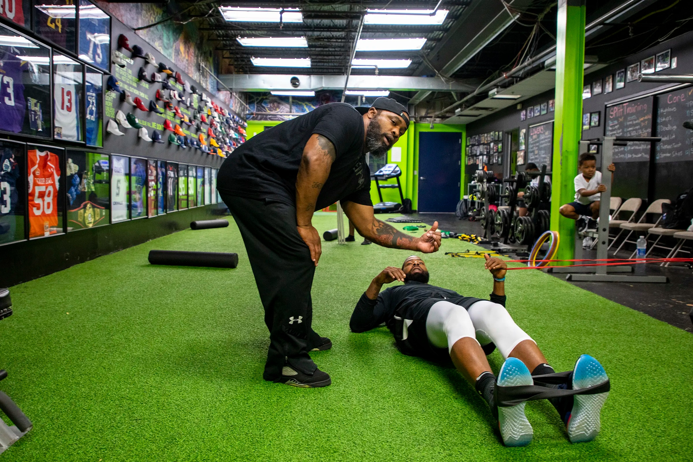 """Greg Garrett, 46, of West Philadelphia, Pa., owner and head strength coach at Level 40 Training & Performance Center, is working with NBA player Marcus Morris, his brother Markieff Morris, and B.J  Johnson on their upper body on Wednesday, July 31, 2019. Garrett has been owner of his facility for seven years and about five years of training the Morris twins. """"We build relationships like no other,"""" Garrett said. """"That bond that you get and to see these guys from nothing to big time athletes."""""""