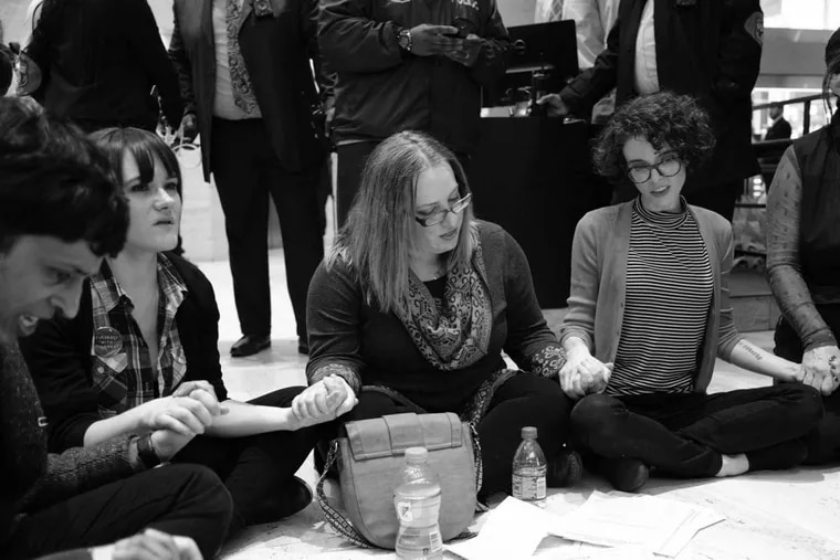 Gwen Snyder, center, at a sit-in demonstration to protest Pat Toomey's stance on healthcare in February 2017.