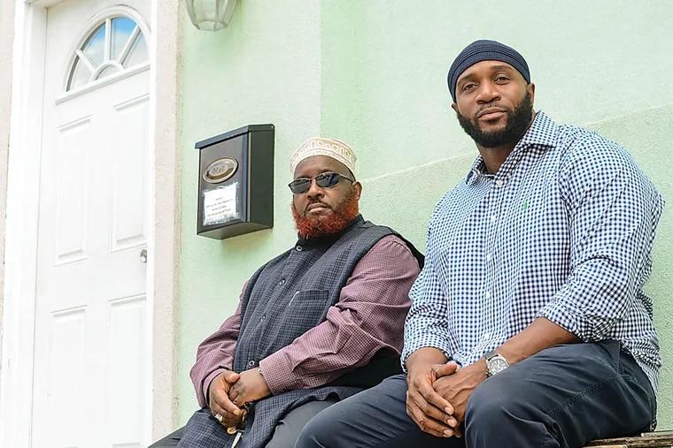 Imam Asim Abdul-Rashid, left, and adminstrator Tariq Salaam, in front of the Masjid Mujahideen mosque in West Philadelphia on Thursday, June 26, 2014.  Andrew Thayer / Staff Photographer