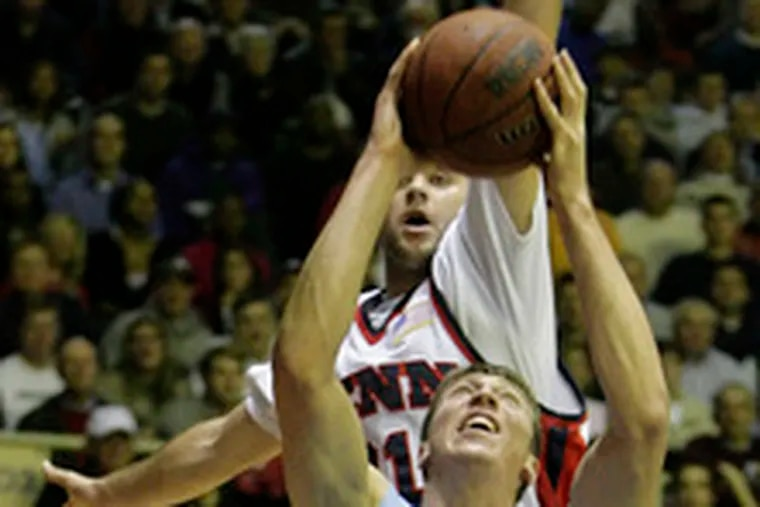 Penn's Brian Grandieri tries to block North Carolina's Tyler Hansbrough, who scored a game-high 29 points against the Quakers in a runaway victory at the Palestra last night.