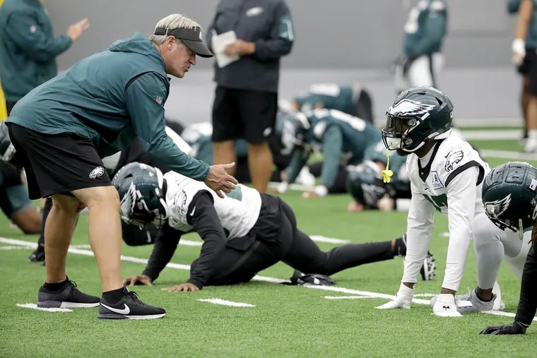 Eagles' head coach Doug Pederson (left) talks with Malcolm Jenkins as the Birds practice in September.