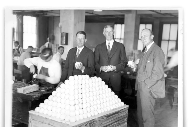 Paying a 1927 visit to A.J. Reach & Co. in Fishtown are (from left) Eddie Collins, Connie Mack, and Ty Cobb of the Philadelphia Athletics. They are examining some of the baseballs that the factory produced for use by the teams in the American League. The factory building is being converted into 30 apartments.