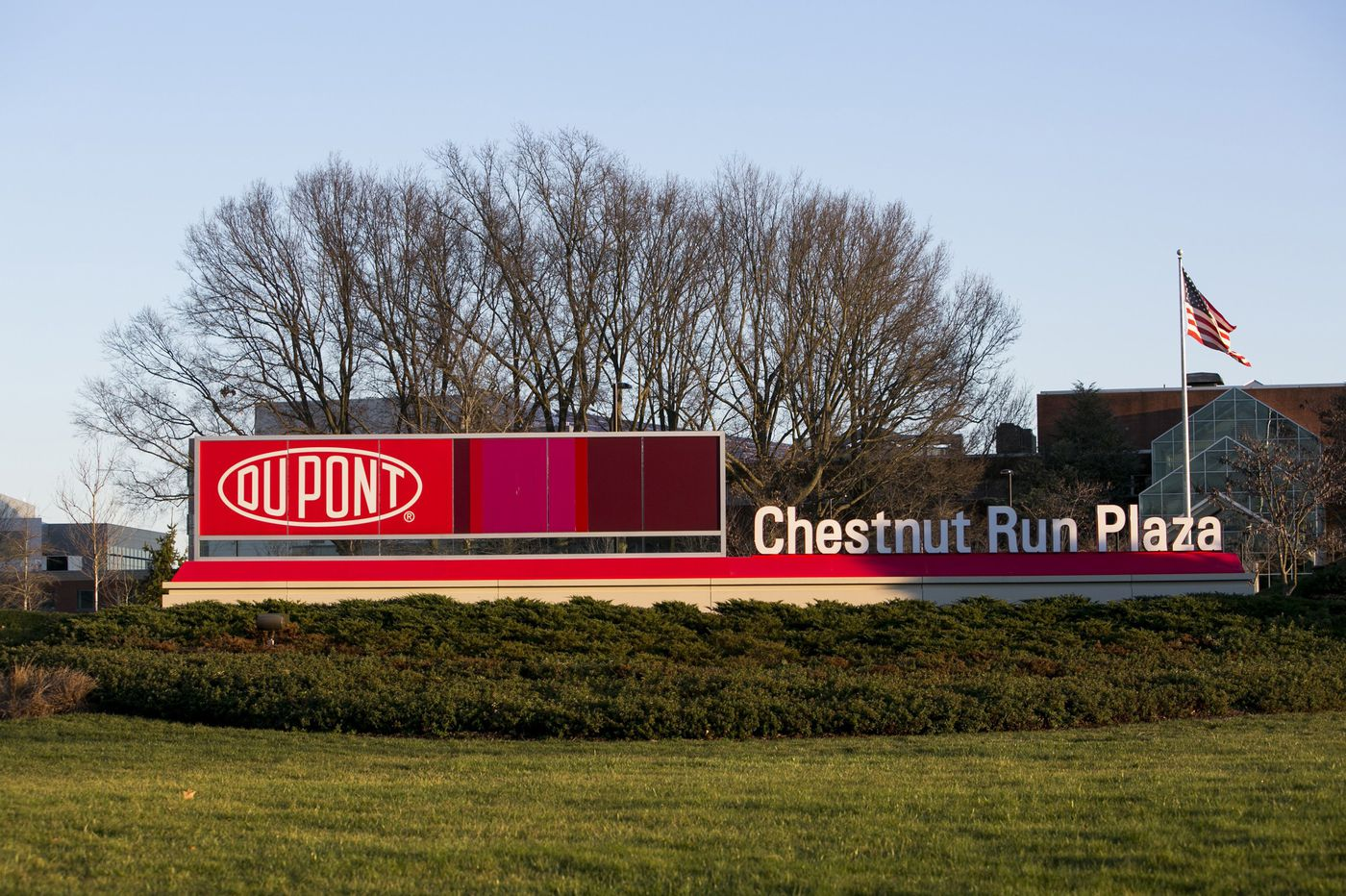 Downsizing DuPont sells chip business for $450 million, spins off consultants