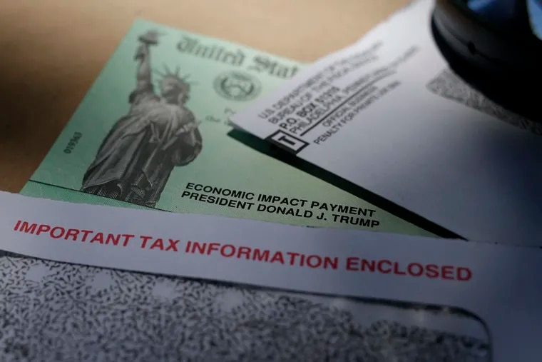 In this April 23 photo, President Donald Trump's name is seen on a stimulus check issued by the IRS to help combat the adverse economic effects of the COVID-19 outbreak, in San Antonio.