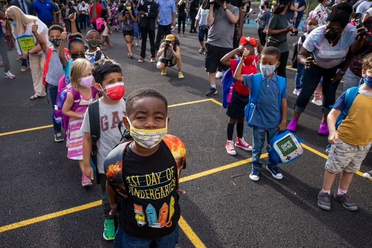 Kindergarteners with mask on wait to start their first day of school at Powel SLAMS a K-8 school at N. 36th and Warren in Philadelphia. Tuesday was the first day of school in the Philadelphia school district.