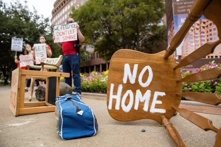"""Protesters place furniture and rally outside the Dallas office of U.S. Sen. John Cornyn, R-Texas, """"to show him the reality of the eviction crisis"""" in this Sept. 1 file photo. The latest stimulus bill extends eviction protections and also includes many tax breaks for small businesses. (Juan Figueroa/The Dallas Morning News/TNS)"""