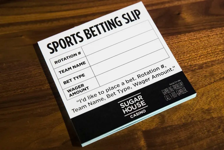 A stack of sports betting slips are displayed at the SugarHouse Casino, where gamblers can now place bets in Philadelphia, Thursday, Dec. 13, 2018. A year-old state law allows owners of Pennsylvania's 12 casinos to pay a $10 million fee to operate sports betting. The U.S. Supreme Court in May cleared the way for states to legalize sports betting. (AP Photo/Matt Rourke)