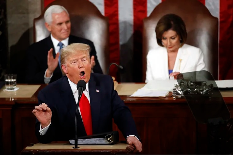 President Donald Trump delivers his State of the Union address to a joint session of Congress on Capitol Hill in Washington on Tuesday as Vice President Mike Pence and House Speaker Nancy Pelosi of California listen.