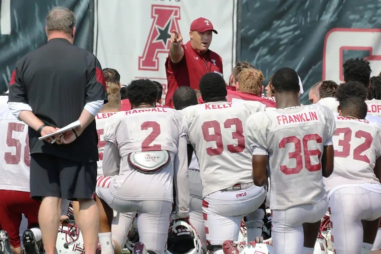OWLSFB06-G 09-05-2017 .(AKIRA SUWA / For The Inquirer).Temple OWLs are practicing at their FB Field. Head Coach, Geoff Collins is talking to players after the practice.