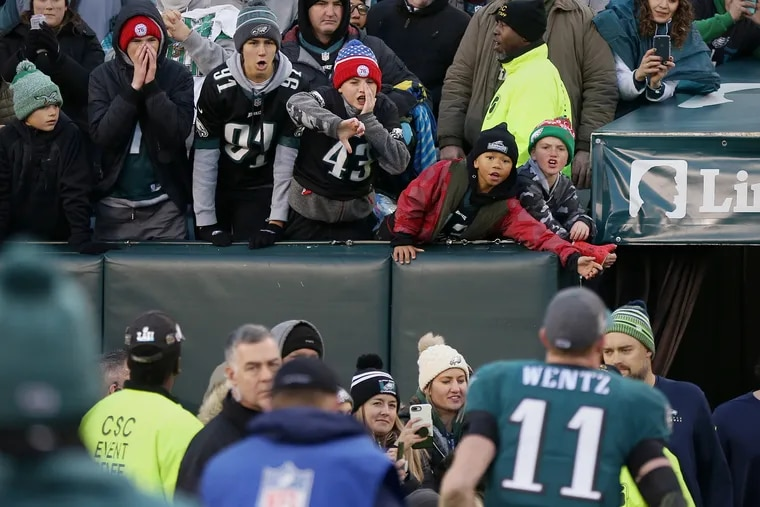 This Inquirer photo of young fans booing Eagles quarterback Carson Wentz after a loss to Seattle last month begs the question: Is humankind really any more unkind today than it's ever been?