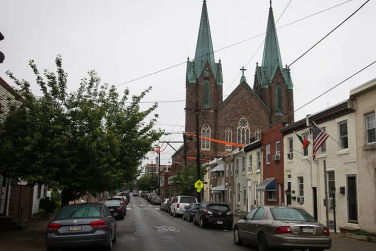 The St. Laurentius Church in Fishtown is known for its soaring copper spires. Its facade has begun to deteriorate in recent years.
