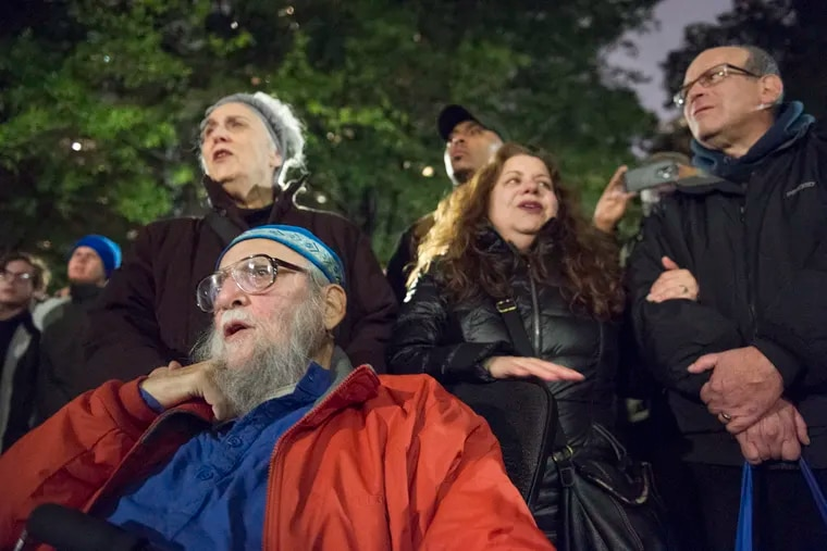 Rabbi Arthur Waskow and Barbara Breitman sing songs in Philadelphia's Rittenhouse Square during a vigil for the victims of the shooting at The Tree of Life Congregation in Pittsburgh.