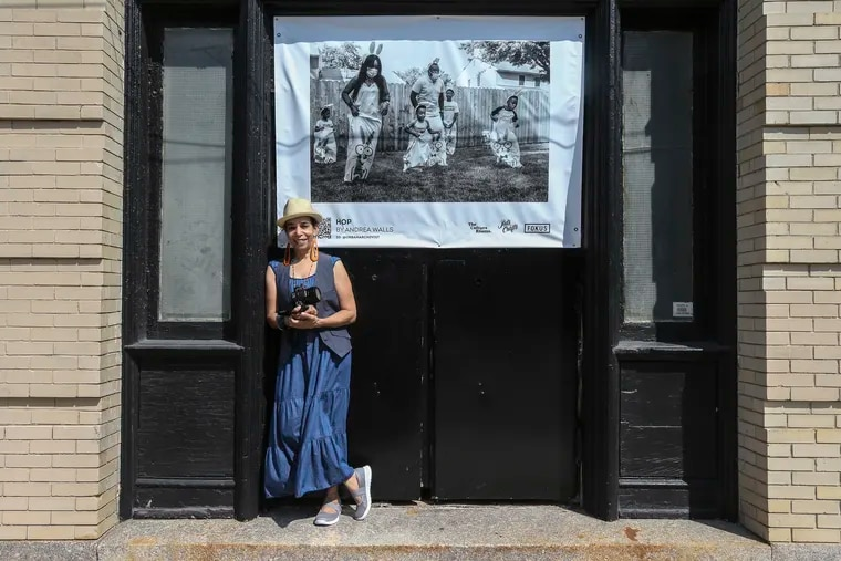 """Andrea """"Philly"""" Walls, the artist and curator behind the Museum of Black Joy. Walls stands in front her work at 915 Spring Garden St., currently featured in the public art exhibition 'Roadmap to Joy.' Friday, July 23, 2021."""