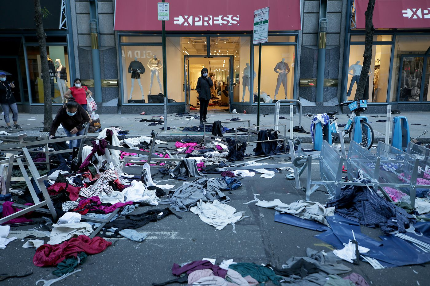The morning after: Shattered windows, burned clothes, businesses destroyed