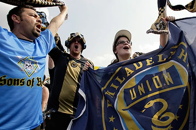 Members of the Sons of Ben dance before the Union play the Seattle Sounders. (Yong Kim / Staff Photographer)