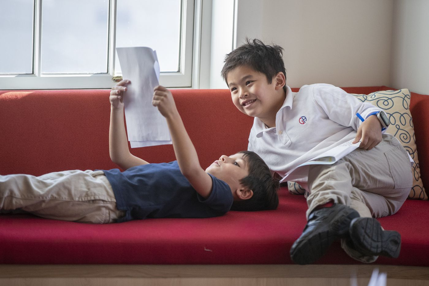 Alexander Paone, left, and Paul Bui, both 6, look over Alexander's report, in the Writers' Cafe area of the new Germantown Academy library and learning commons. The New York-based architecture firm that designed it incorporated elements from students' designs.