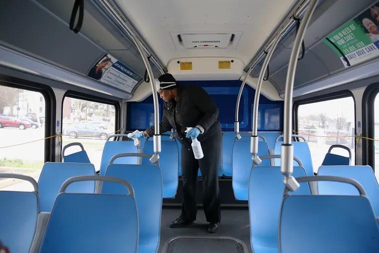 SEPTA driver Allison Cooper sanitizes handles on a bus at the Fern Rock Transportation Center in North Philadelphia on Wednesday, March 25, 2020.