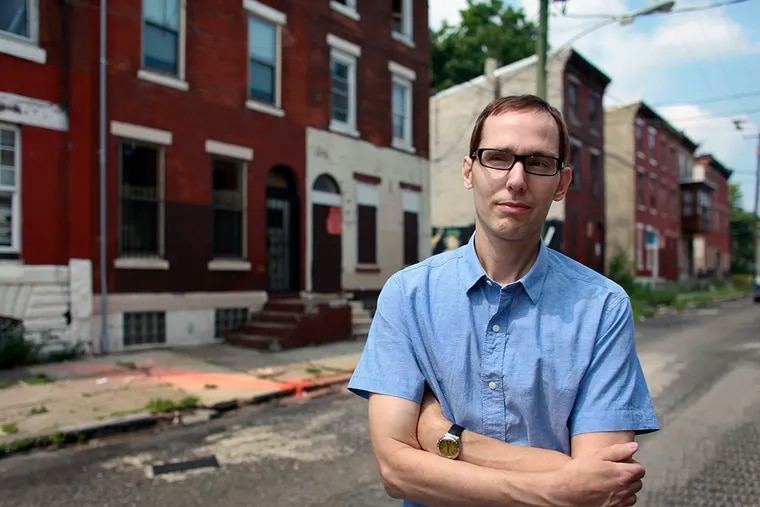 Developer Glenn Mancini in front of a property he is renovating on Master Street in North Philadelphia. The Philadelphia Housing Authority is taking two of his properties, and 1,300 others, in the neighborhood. (JOSEPH KACZMAREK / For The Inquirer)
