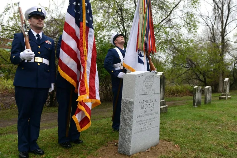 A Coast Guard Color Guard at the headstone for Kathleen Moore, who died in 1899.