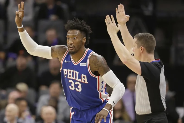 Sixers forward Robert Covington flashed three fingers after scoring from long range in the Sixers' 109-108 loss to the Kings on Thursday.
