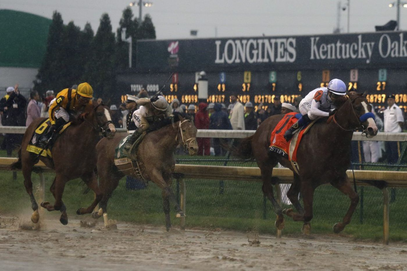 Justify makes history in rain-soaked Kentucky Derby victory