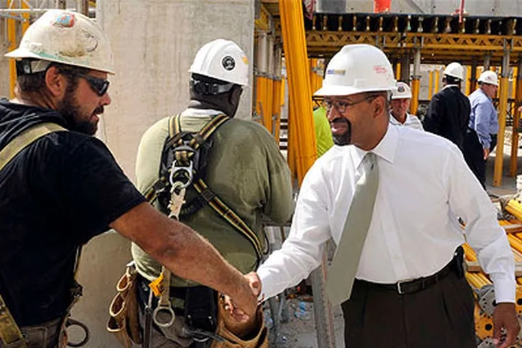 Mayor Nutter greeting construction workers at the Granary apartments site in Franklintown on Wednesday, after announcing the city's rewritten zoning code. (Tom Gralish / Staff Photographer)