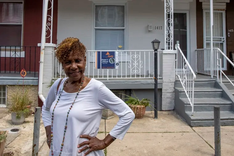 Real estate investor Joanne Bourne outside a three-bedroom rowhouse she and business partner Angela Dickerson recently bought, rehabbed, and sold on the 1400 block of North Hirst Street in West Philadelphia.