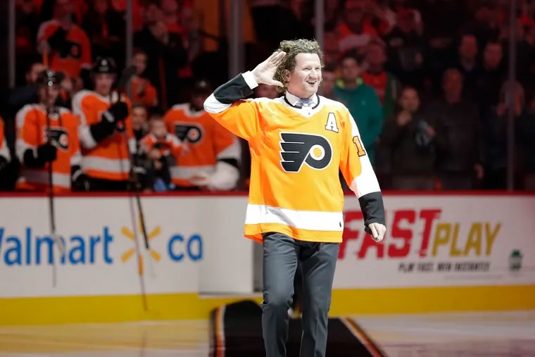 Scott Hartnell walking onto the ice at the Wells Fargo Center in 2018 before dropping the ceremonial first puck.